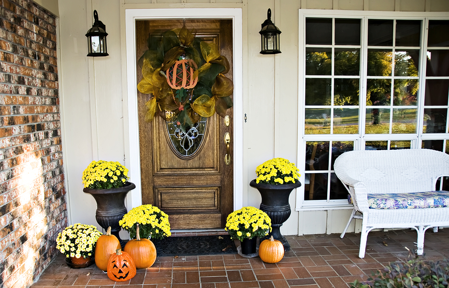Front Fall Entryway: An entryway decorated for fall and Halloween.